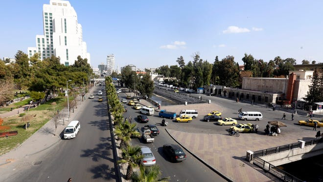 Vehicles drive at a street after a ceasefire that went into effect in the capital Damascus, Syria, on Feb. 27, 2016.