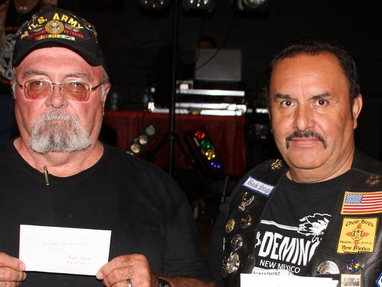 Chuck Metevier, left was the high-hand winner and Mike