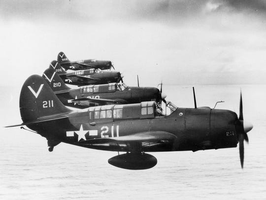 SB2C-4E Helldivers with Bombing Squadron 87 flying from USS Ticonderoga, May 1945.