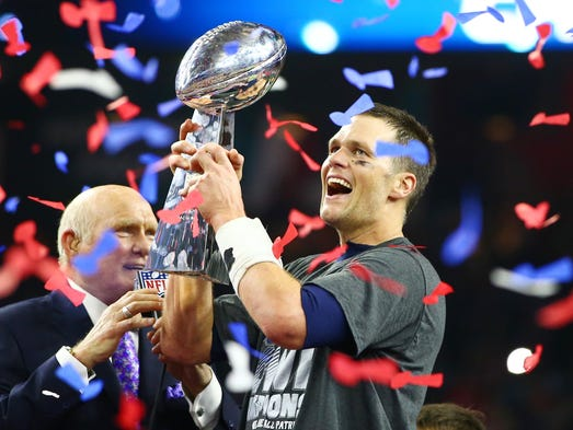 Tom Brady hoists the Lombardi Trophy after the Patriots