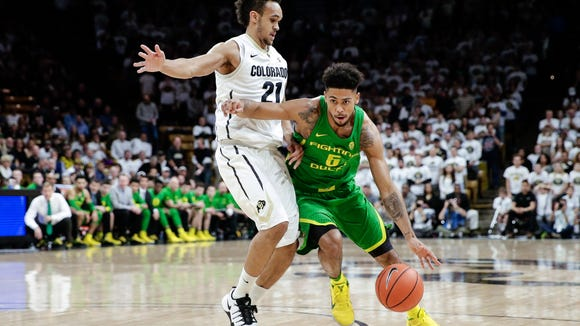 Jan 28, 2017; Boulder, CO, USA; Colorado Buffaloes guard Derrick White (21) defends against Oregon Ducks guard Tyler Dorsey (5) in the first half at Coors Events Center. Mandatory Credit: Isaiah J. Downing-USA TODAY Sports