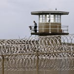 In this 2011 Statesman Journal file photo, a correctional officer mans a tower at the Oregon State Penitentiary.