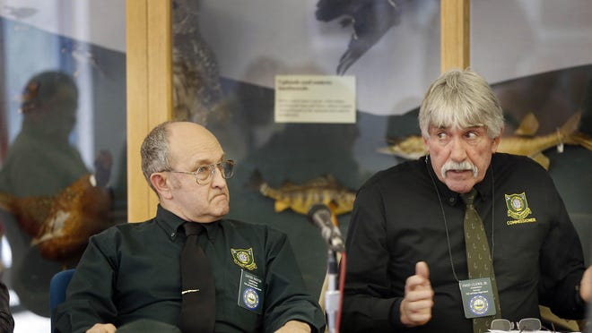 Fish and Game Commissioner David Patch, left, listens as fellow Commissioner Fred Clews speaks against a state hunting and trapping season for bobcats Wednesday in Concord, N.H.