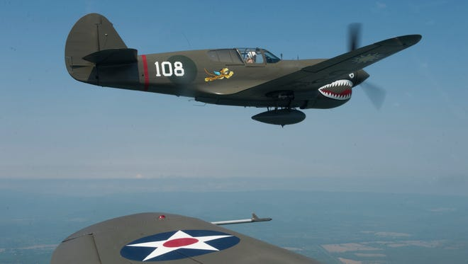 Flyover practice with P-40E War Hawks.