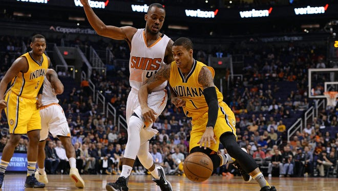 Indiana Pacers guard Joe Young (1) drives the ball against Phoenix Suns guard Lorenzo Brown (41) in the first half at Talking Stick Resort Arena.