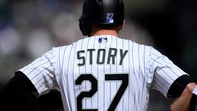 Colorado Rockies shortstop Trevor Story (27) standing on third base in the second inning against the San Diego Padres at Coors Field on Saturday. Story is off to a historic start in his rookie season.