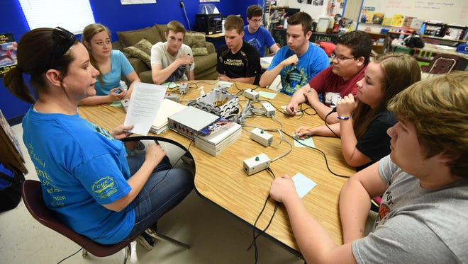 Cotter Quiz Bowl coach Monica Springfield leads practice as team members (from left) Emily Krause, Trenton Tardiff, Grant Dodson, coach Jordan Crawford, Dalton Orsborn, Gabe Gilley, Samantha Hodges and Austin McBee listen to questions.