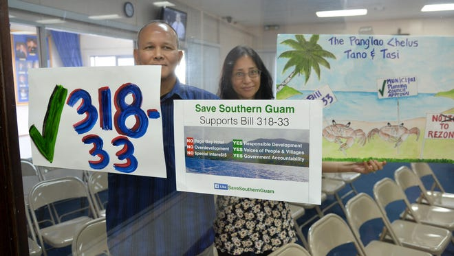 "Adrian Gogue, left, and Joanna Gogue, of Chalan Pago, show their support for a bill during a legislative session in Hagåtña on Nov. 23, 2016. Bill 318-33, which aims to require the approval of municipal planning councils for proposed zoning changes or variances, was discussed by lawmakers during the session.  ""Since when is giving a chance for the voice of the people a bad thing, in a democracy?"" said Adrian Gogue."