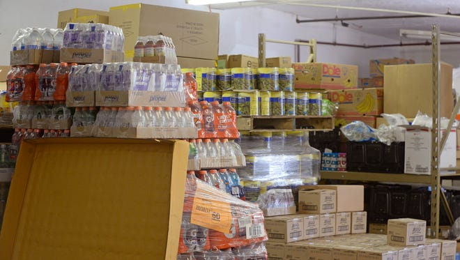 Stockpiles of food and other items sit in the warehouse portion of the Gateway Hunger Relief Center on Sheridan Street in Richmond.