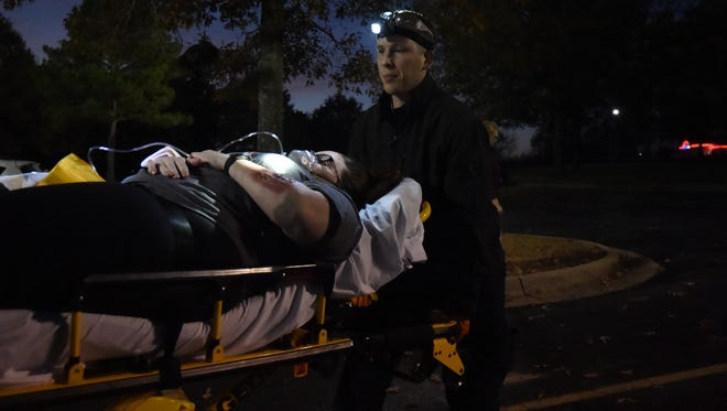 Several people volunteered as actors during Arkansas State Univerisity-Mountain Home's mass casualty drill Wednesday evening. The drill simulated a gasoline truck that exploded, leaving people injured.