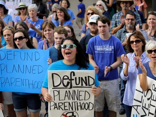 Erica Canaut, center, cheers as she and other anti-abortion