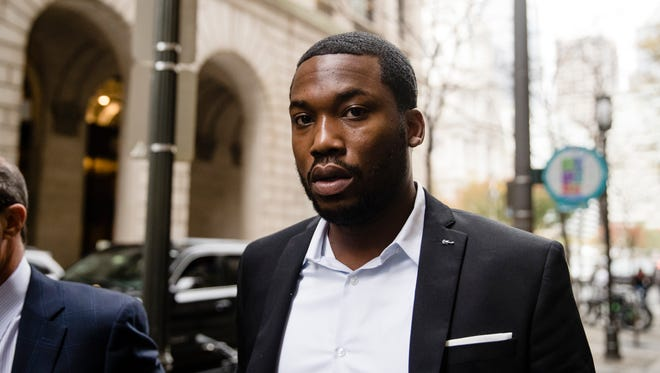 Rapper Meek Mill arrives at the criminal justice center in Philadelphia on Monday. A judge sentenced him to two to four years in state prison for violating probation in a nearly decade-old gun and drug case.