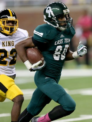 Cass Tech's Donovan Peoples-Jones runs by Detroit Martin Luther King's Jalen Embry for a touchdown during second quarter action October 25, 2013 at Ford Field.