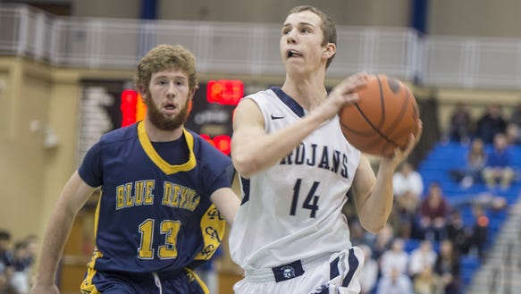 Chambersburg's Cade Brindle, right, looks for a shot
