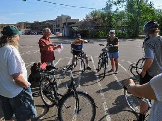 Bob Fisch, second from left, helps a group of Poky Pedalers get started at at 2015 ride.