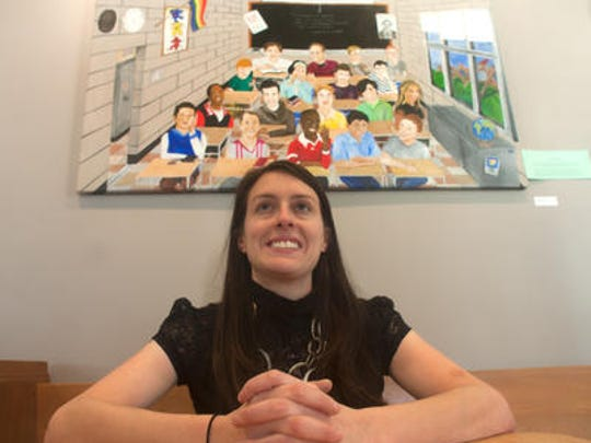 """Maple Shade High School art teacher Jennifer Braverman sits in front of one of her pieces titled """"Safe Space,"""" which is part of an exhibit called """"Invisible Identity"""" at the Eilandarts Center at The Station in Merchantville."""
