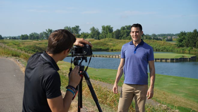 Bogdan Zlatkov films Tyler Ham Pong at Eagle Eye Golf Course for a tourism commercial aimed at Canadians, the city's top international visitors.