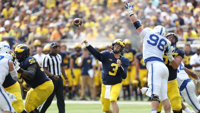 Wilton Speight passes in the third quarter of Michigan's 29-13 win over Air Force, Saturday, Sept. 16, 2017 at Michigan Stadium.