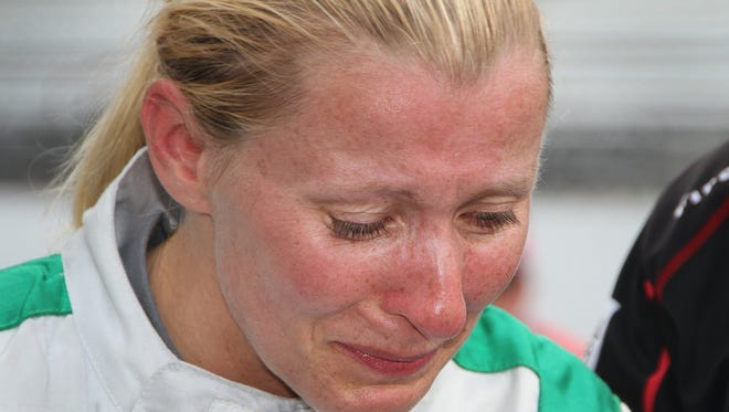 An emotional Dale Coyne Racing IndyCar driver Pippa Mann (63) reacts after she failed to make the field of 33 cars on qualification day for the Indianapolis 500 at the Indianapolis Motor Speedway on Saturday, May 19, 2018.