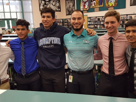 Five seniors from Gulf Coast's 2018 state champion boys soccer team signed to play in college at a ceremony at the school Wednesday, April 11, 2018. From left to right: Frankie Rodriguez (Shorter University), Sebastian Joffre (Eastern Florida State College), Sebastian Jimenez (Assumption College), coach Alan Scott, Stephen Votapek (Berry College), Luis Ortiz (Gardner-Webb).