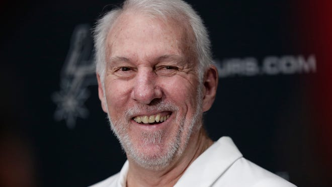 FILE - In this Sept. 30, 2019, file photo, San Antonio Spurs head coach Gregg Popovich talks with the media during NBA basketball media day in San Antonio. Freshmen at the United States Air Force Academy are called doolies, and the experience for those first-year cadets can be extremely difficult. Popovich, class of 1970, hasn't forgotten those days. And for the San Antonio coach, a couple days of lockdown at Walt Disney World brought back the memories of doolie life.