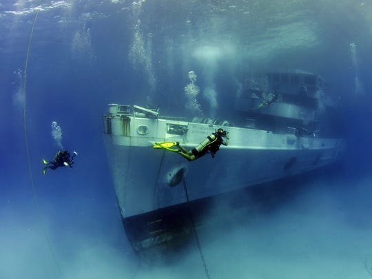 The USS Kittiwake was sunk in 2011 near the Cayman Islands to create a dive site and artificial reef. A Port Washington group plans to sink a large ship, along with cars and small boats, to create an artificial reef and dive site in Lake Michigan.