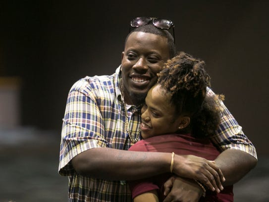 Destanni Henderson gets a hug from David Anderson after