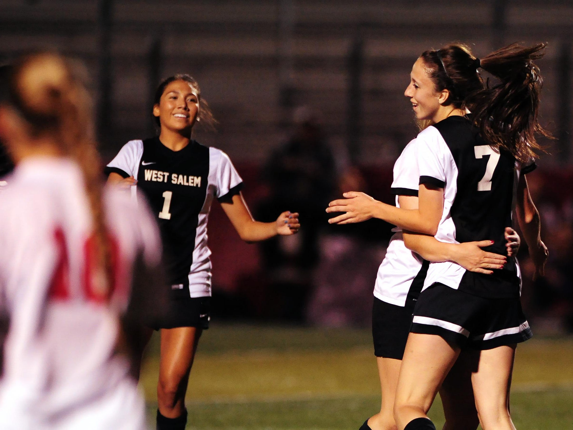 West Salem's Paula-Marie Labate (7) celebrates with teammates after scoring her second goal of the game against South Salem during a Greater Valley Conference game, Wednesday, Oct. 6, 2015, in Salem, Ore.