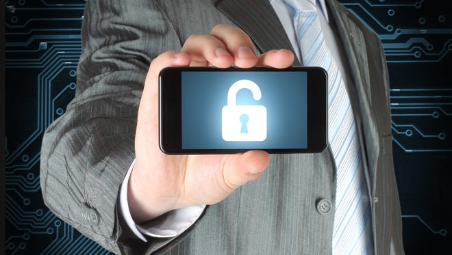 Businessman holds smart phone with open lock on white background, security concept