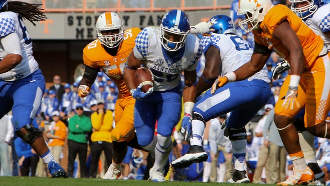 Nov 12, 2016; Knoxville, TN, USA; Kentucky Wildcats running back Benny Snell Jr. (26) runs the ball against the Tennessee Volunteers during the first half at Neyland Stadium.