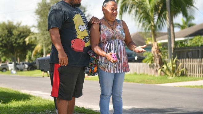 "Jose Crespo (left) comforts his mother Ana H. Rosado, as she morns the loss of her daughter, and his sister, Maribel Morales-Rosado, who was shot at her home in Indiantown on Tuesday, Aug. 11, 2020, by her ex-boyfriend Donald L. Williams according to Martin County Sheriff William Snyder, and died from her injuries. ""She wants justice for her daughter,"" Crespo said of his mother's wishes, as they mourn in front of Maribel's home on Wednesday, Aug. 12, 2020, in Indiantown."