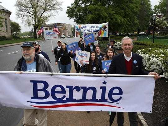 Richard Askins, l, of Hillsdale and Assemblyman John Wisniewski,  New Jersey Assembly Speaker and NJ State Chair of the Bernie Sanders for President Campaign lead the  'Bernie Sanders Around the Green' march. Supporters of the Vermont U.S. Senator marched from Pioneer Par around the Morristown Green to raise awareness of voting registration and supporting Sen. Sanders for the Democratic nomination for president. May 7, 2016. Morristown, N.J.