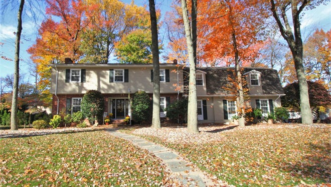 This expanded Colonial has a guest suite with a separate entrance and four other bedrooms.