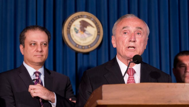 New York City Police Commissioner William Bratton, right, discusses the arrest of four people in connection with New York City's ongoing corruption probe as U.S. Attorney Preet Bharara, left, looks on, Monday, June 20, 2016, in New York. Two high-ranking New York Police Department officials and a police sergeant who oversaw gun license applications were among the latest arrests in a case that has cast a cloud over the nation's largest municipal police force. (AP Photo/Mark Lennihan)