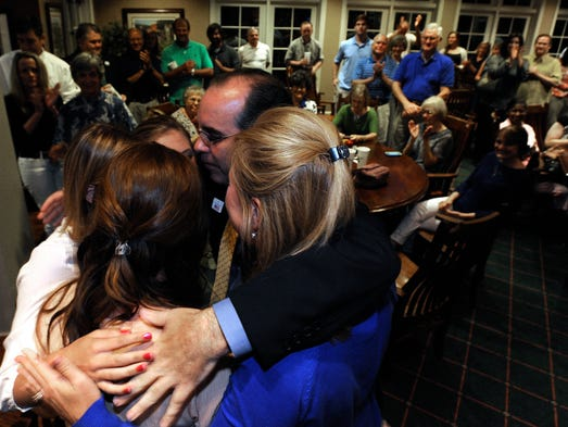 Clyde Chambliss shares a group hug with his family as hecelebrates victory in the republican runoff election for Senate Seat 30 race with supporters in Prattville, Ala. on Tuesday July 15, 2014.
