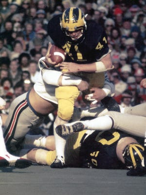 Coach Jim Harbaugh, a ballboy when Rob Lytle played at U-M, waxed poetic about how Lytle lowered his pads.