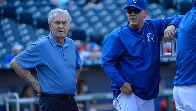 David D. Glass, right, owner and CEO of the Kansas City Royals, talks with manager Ned Yost while watching batting practice before a baseball game on Aug. 14, 2015, in Kansas City.