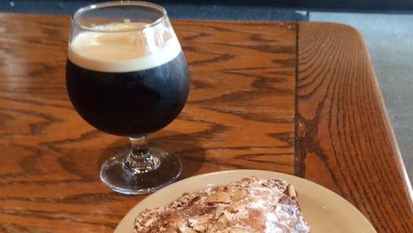 Nitro coffee and an almond croissant. The coffee was