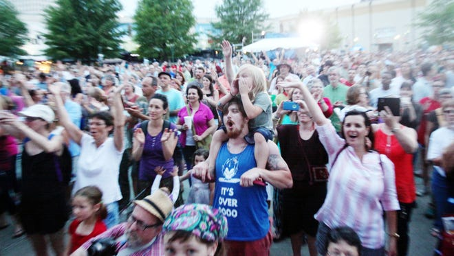The crowd cheers as Zachary Richard, with the help of French Immersion students and other local musicians, closes out his set at Scne Stabil Drill International during Festival International de Louisiane Thursday, April 23, 2015, in downtown Lafayette, La.