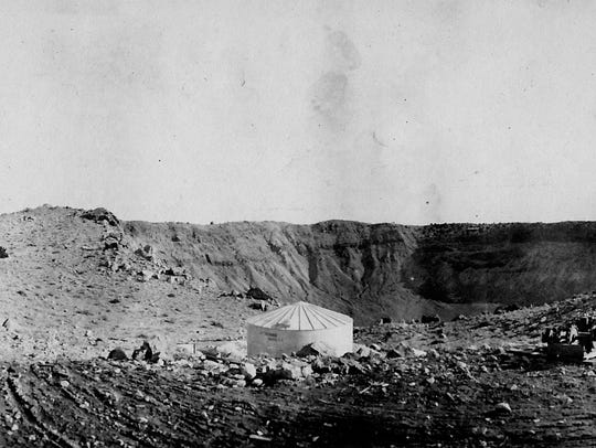 A water tank sits at the base of Meteor Crater, ca.