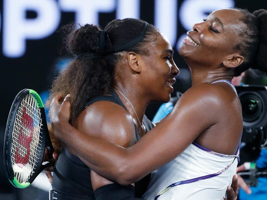 Serena Williams (left) embraces her sister, Venus, after beating her to win the Australian Open. It was Serena's 23rd Grand Slam title, a record in the Open era.