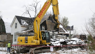 Carrie Lewand-Monroe has been named executive director of the Detroit Land Bank Authority which is a key player in Detroit's blight removal effort, as shown by this demolition of a house on Lyon Street in southwest Detroit in November 2015.