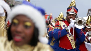 The Detroit Public Schools All City High School Marching Band gets ready to march in America's Thanksgiving Parade in Detroit on Thursday, November 26, 2015.