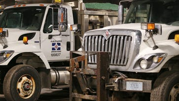 Trucks filled with salt wait to be dispatched at the Indianapolis Department of Public Works operations center on Thursday evening. This week's springlike temperatures are expected to drop  before the Friday morning commute, posing the possibility of icy roads.