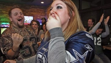 Amanda Bauer's hopes of a Cowboy win fade as her husband, Greg Bauer, a Mukwonago High School alumnus, celebrates the Packers while watching the game against the playoff game on Jan. 15 at the Smokehouse. Amanda, formerly of Eagle and head bartender at David Alan Alan's Smokehouse in Mukwonago, is long-time Dallas Cowboys fan.