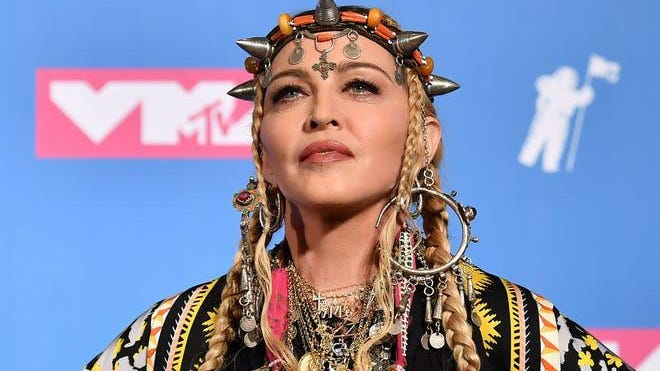 "Madonna's Instagram account has been flagged for spreading ""False Information."""