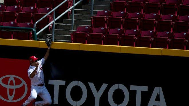 Cincinnati Reds center fielders Shogo Akiyama (4) hits the wall as a ball hit by Chicago Cubs center fielder Ian Happ leaves the Great American Ball Park for a two-run home run in the fifth inning of a Major League Baseball game Sunday Aug. 30, 2020, in Cincinnati.