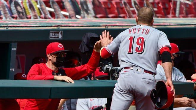 Cincinnati Reds designated hitter Joey Votto (19) is congratulated by teammates after scoring during the third inning of a Major League Baseball game on Sunday Sept. 13, 2020, at Busch Stadium in St. Louis.