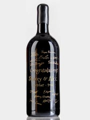 This Oct. 2014 photo shows a 3L size bottle of Cabernet Sauvignon that was used as a guest book for a wedding in Austin, Texas. After the attendees signed the bottle, it was engraved and painted over on the signatures to preserve it.