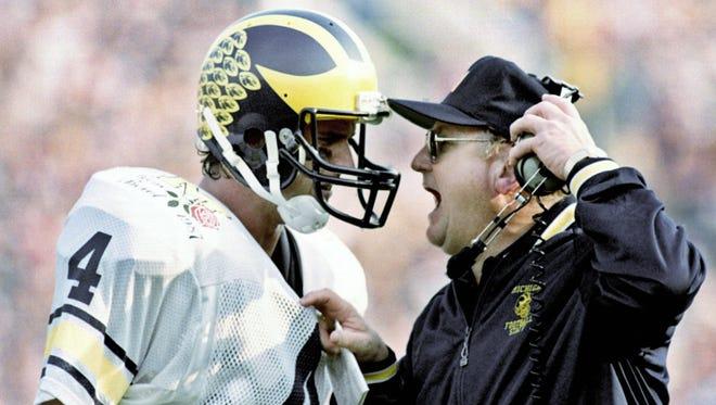 Michigan football coach Bo Schembechler yells at quarterback Jim Harbaugh at the Rose Bowl on Jan. 2, 1987.